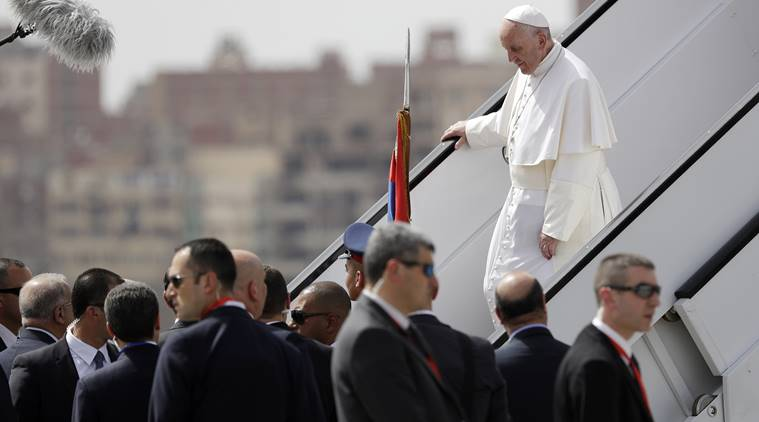 Pope Francis walks down the steps of an airplane upon arriving at Cairo's airport, Egypt, Friday, April 28, 2017. Francis is in Egypt for a two-day trip aimed at presenting a united Christian-Muslim front that repudiates violence committed in God's name. (AP Photo/Gregorio Borgia)